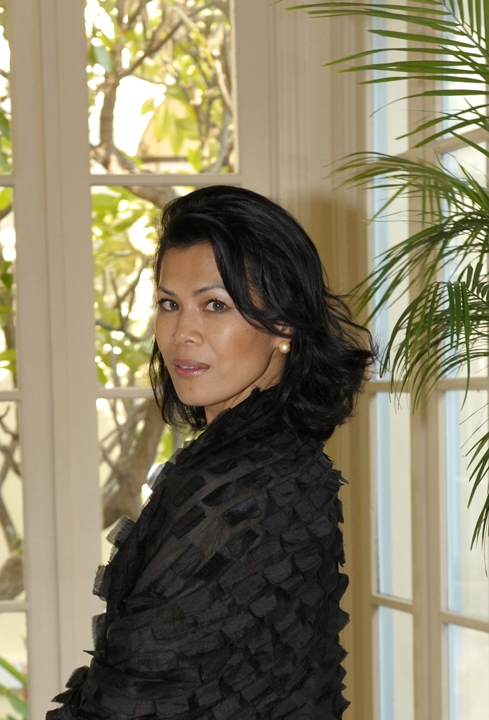 Theary Seng wrapped in Eric Raisina silk scarf, Dec. 2009
